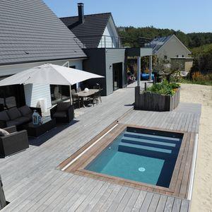 Terrasse piscine mobile bord de plage